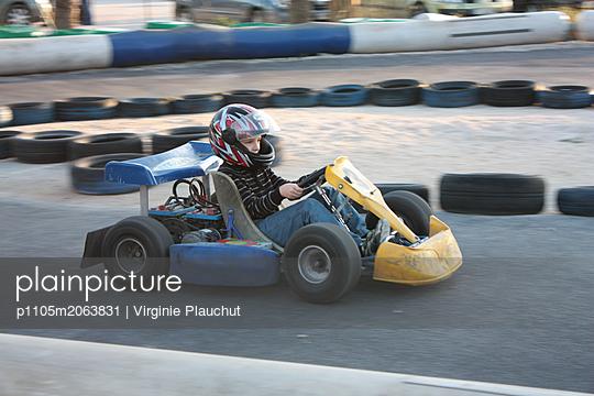 Driving on a kart track - p1105m2063831 by Virginie Plauchut