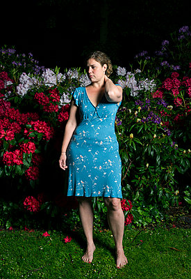 Woman and rhododendron at night - p1132m925556 by Mischa Keijser