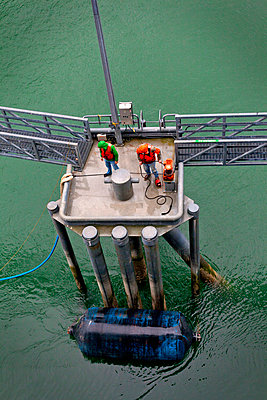 High angle view of workers at oil refinery - p1166m968847f by Cavan Images