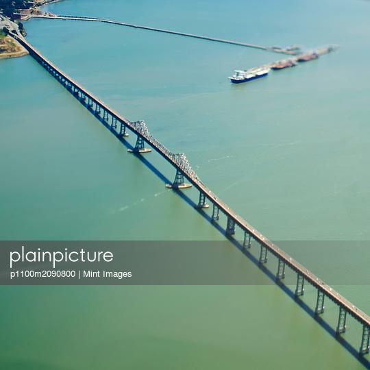 Bridge Over a Large Bay - p1100m2090800 by Mint Images
