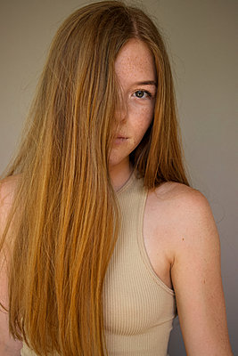 Portrait, teenage girl with freckles and long hair - p1640m2245818 by Holly & John