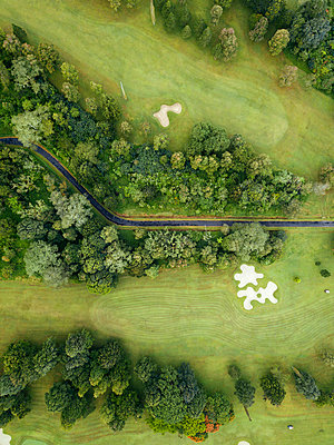 Indonesia, Bali, Aerial view of golf course with bunker and green - p300m2024006 by Konstantin Trubavin