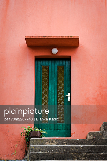 Croatia, Door and orange facade - p1170m2237740 by Bjanka Kadic