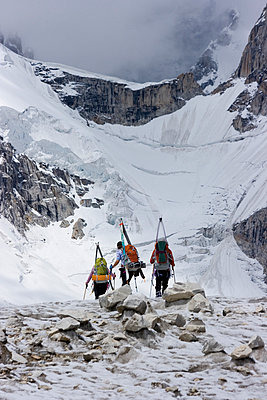 Three ski mountaineers walking on the Biafo glacier in the Karakoram Himalaya of Pakistan - p343m1032084 by Bill Stevenson