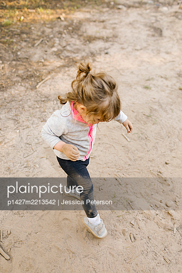 Girl (2-3) playing in sand, Wasatch Cache National Forest - p1427m2213542 by Jessica Peterson