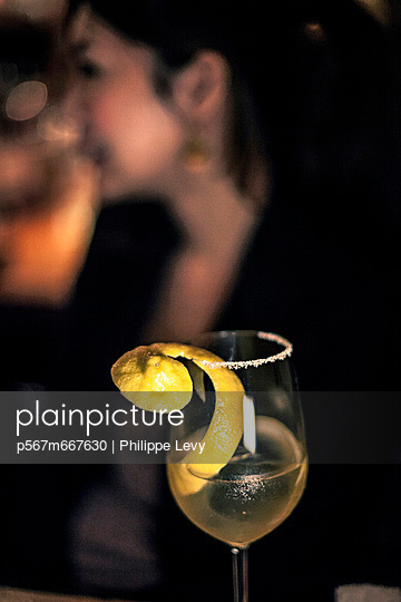 Woman in a bar in Tokio - p567m667630 by Philippe Levy