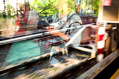 Travelers in a subway, reflections, blurred motion - p1686m2288542 by Marius Gebhardt
