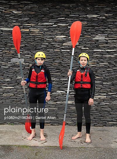 Two teenage boys as kayakers  - p1082m2196349 by Daniel Allan