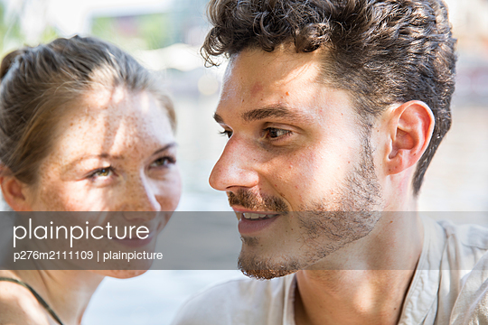 Young woman in love is looking at her boyfriend - p276m2111109 by plainpicture