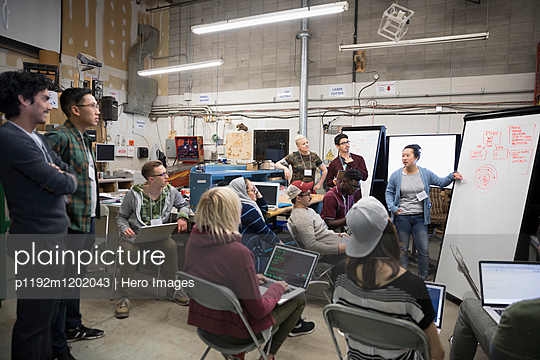 Hackers pitching ideas at hackathon in workshop - p1192m1202043 by Hero Images