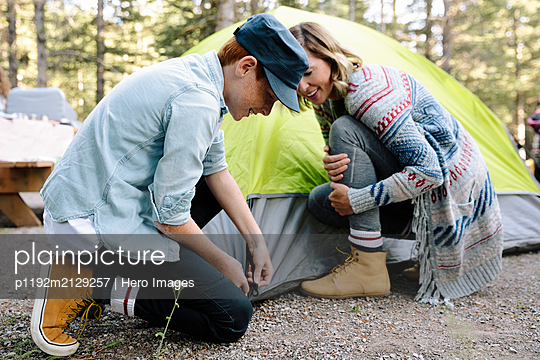 Mother and son preparing tent at campsite - p1192m2129257 by Hero Images