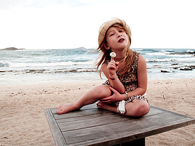 Girl posing on beach  - p972m1160348 by Stefan Andersson