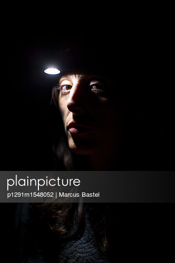 Woman with head headtorch - p1291m1548052 by Marcus Bastel