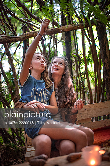 Two girls playing together in a cabin in the forest - p1007m2220018 by Tilby Vattard