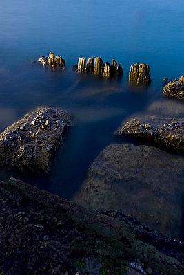 Rocks in Water - p1331m1169260 by Margie Hurwich