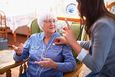 Medic caring for senior woman at home - p300m978758f by zerocreatives
