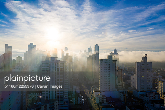Aerial view of mist covering the city of Bal. Camborǐ early mo - p1166m2255976 by Cavan Images