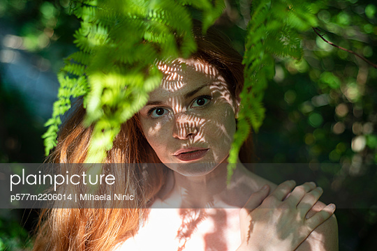 Woman in shadow - p577m2206014 by Mihaela Ninic