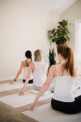 Women at yoga retreat - p429m2019504 by Hugh Whitaker