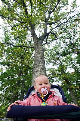 A baby girl in a pram - p5755574f by Fredrik Schlyter