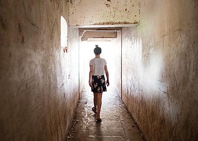 Girl Walking Through Tunnel - p1503m2020415 by Deb Schwedhelm