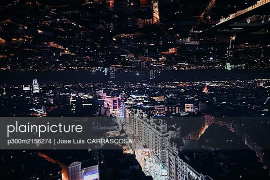 Spain, Madrid, Double exposure of illuminated Gran Via street at night - p300m2156274 by Jose Luis CARRASCOSA