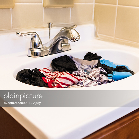 Laundry in the sink - p758m2183892 by L. Ajtay