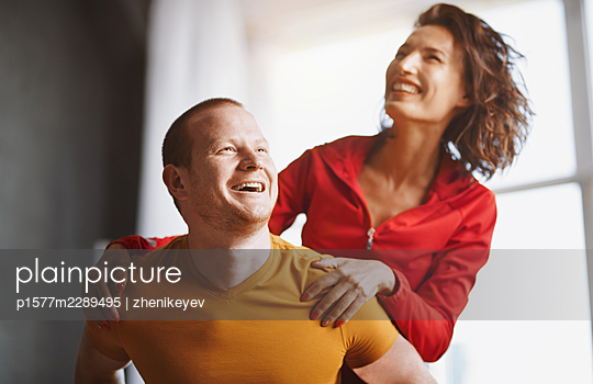 Redhead man and Asian woman having fun - p1577m2289495 by zhenikeyev