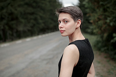Caucasian woman standing near road - p555m1504283 by Vyacheslav Chistyakov