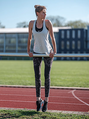 Germany, Hannover, Young woman at sports stadium - p1600m2230802 by Ole Spata