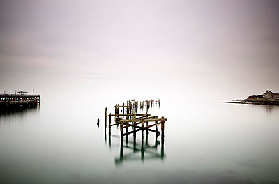Remains of the old pier on misty morning, Swanage, Dorset, England, United Kingdom, Europe - p8710552 by Lee Frost