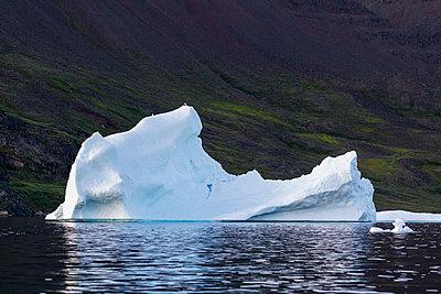 Melting iceberg in Disko Bay West Greenland - p1023m2161534 by Martin Barraud