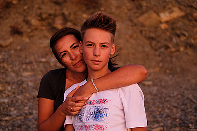 Mother and son outdoors - p1363m2142664 by Valery Skurydin