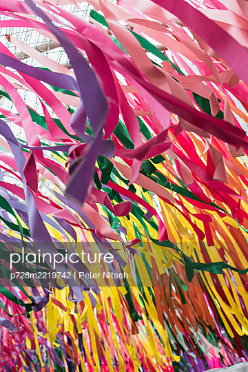 Colorful ribbons of crepe paper - p728m2219742 by Peter Nitsch
