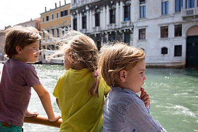 Kids on a boat in Venice - p1308m2126705 by felice douglas