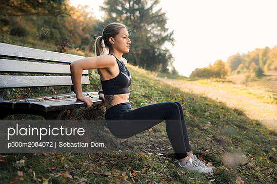 Young woman during workout on a bench