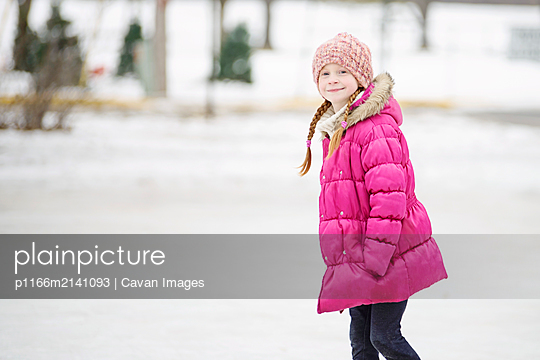 Little Girl Ice Skating Outdoors - p1166m2141093 by Cavan Images
