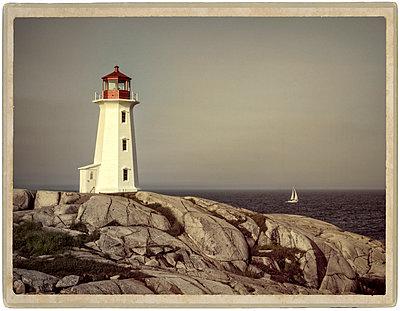 Lighthouse Peggy's Point on rocky coast - p1154m1110183 by Tom Hogan