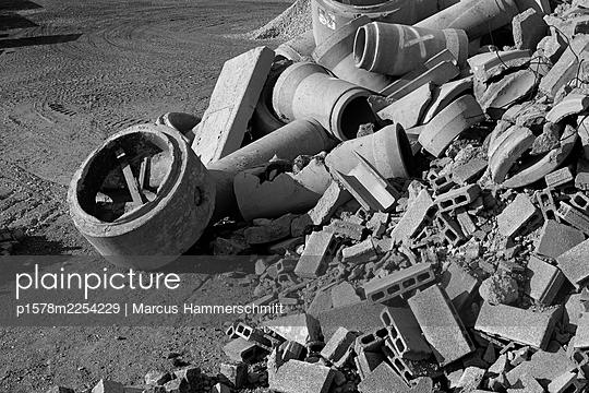Building rubble at construction site - p1578m2254229 by Marcus Hammerschmitt
