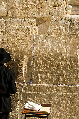 A man praying at the Wailing Wall - p3017837f by Adam Burn