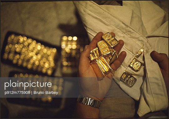 Gold bars - p912m775908 by Bruno Barbey