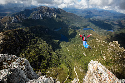 BASE jumper in free fall, New South Wales, Australia - p343m1576769 by Kamil Sustiak