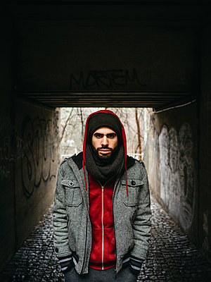Man with full beard in winter clothing in a tunnel - p1267m2258812 by Jörg Meier