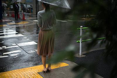 Woman with umbrella - p1321m2126148 by Gordon Spooner