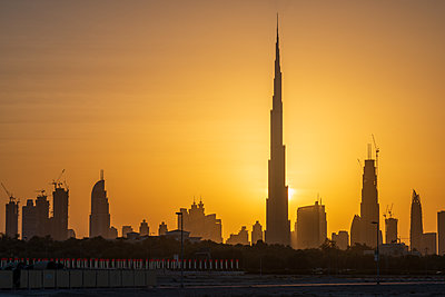 Dubai, skyline at sunset - p1575m2209363 by thomas kohnle