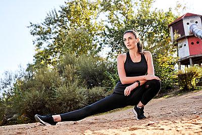 Sportive woman stretching leg - p300m2003926 by Markus Mielek