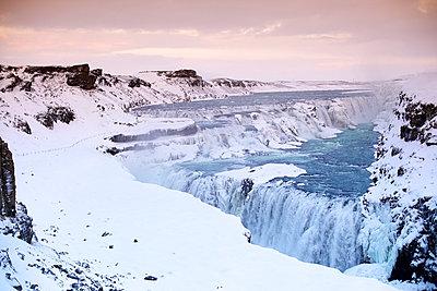 Waterfall in winter - p606m960651 by Iris Friedrich