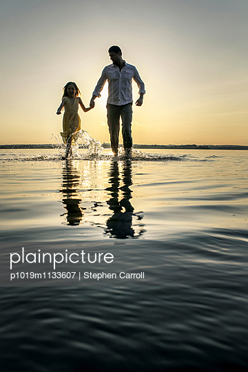 Father and Daughter at Sunset - p1019m1133607 by Stephen Carroll