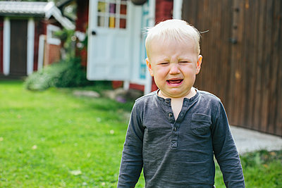 Crying boy - p312m1121547f by Anna Rostrom