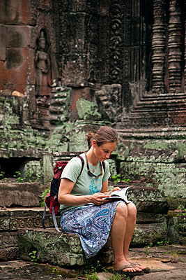 A woman  explores Angkor Wat, Cambodia - p343m964492 by Mark Fisher